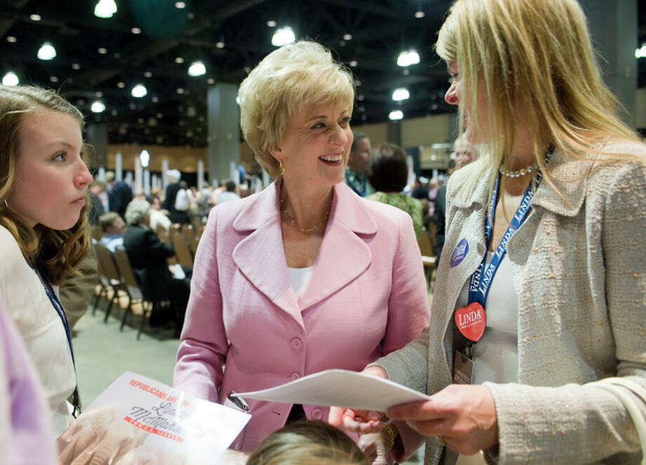 Republican candidate for U.S. Senate Linda McMahon, center, speaks with supporter Maureen Gagnon at the Republican state convention in Hartford, Conn., Friday, May 18, 2012. (AP Photo/Jessica Hill) / AP2012