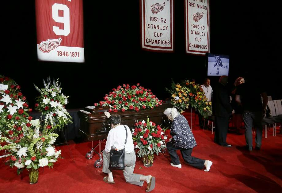 Two women pay their respects to Gordie Howe, the man known as Mr. Hockey, at Joe Louis Arena, the home of the Detroit Red Wings, his team for much of his NHL Hall of Fame career, Tuesday, June 14, 2016 in Detroit. (AP Photo/Carlos Osorio, Pool) Photo: Carlos Osorio, Associated Press
