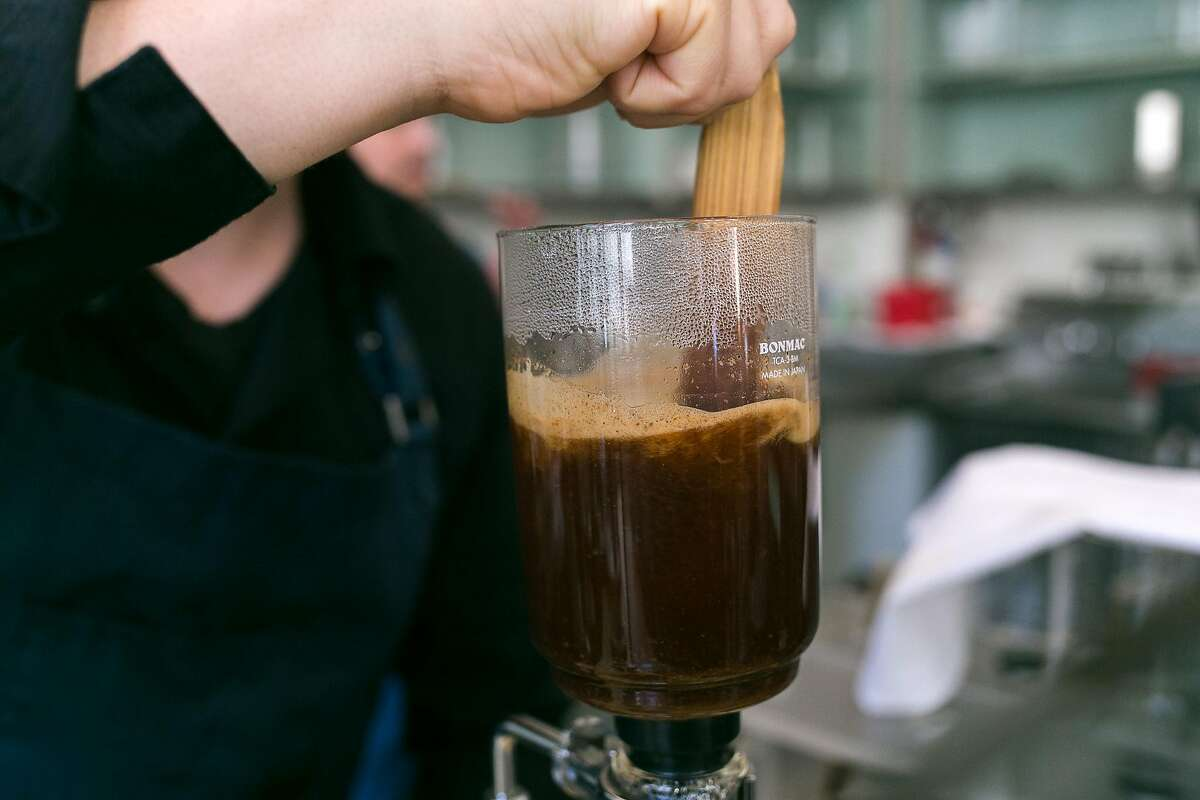 Jason Smith agitates the water and coffee grounds at Blue Bottle Coffee in SOMA.