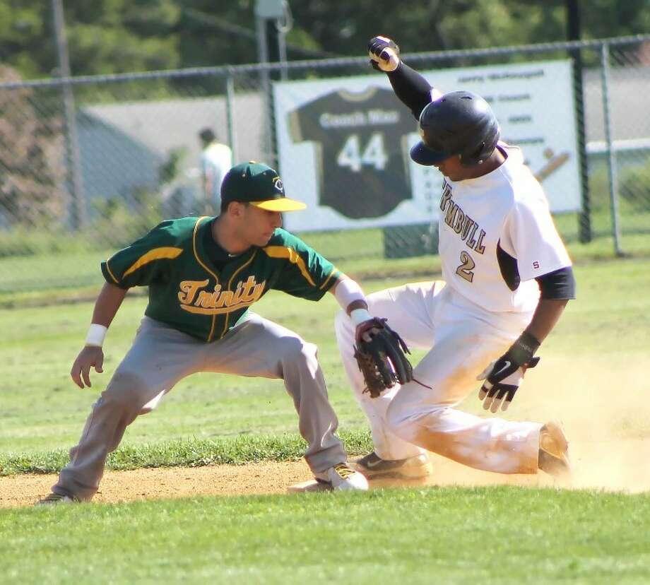 Photo by Joe Ryan - Trumbull's Marcus Jenkins, right, steals second base as Trinity Greg Hajjar applies tag.