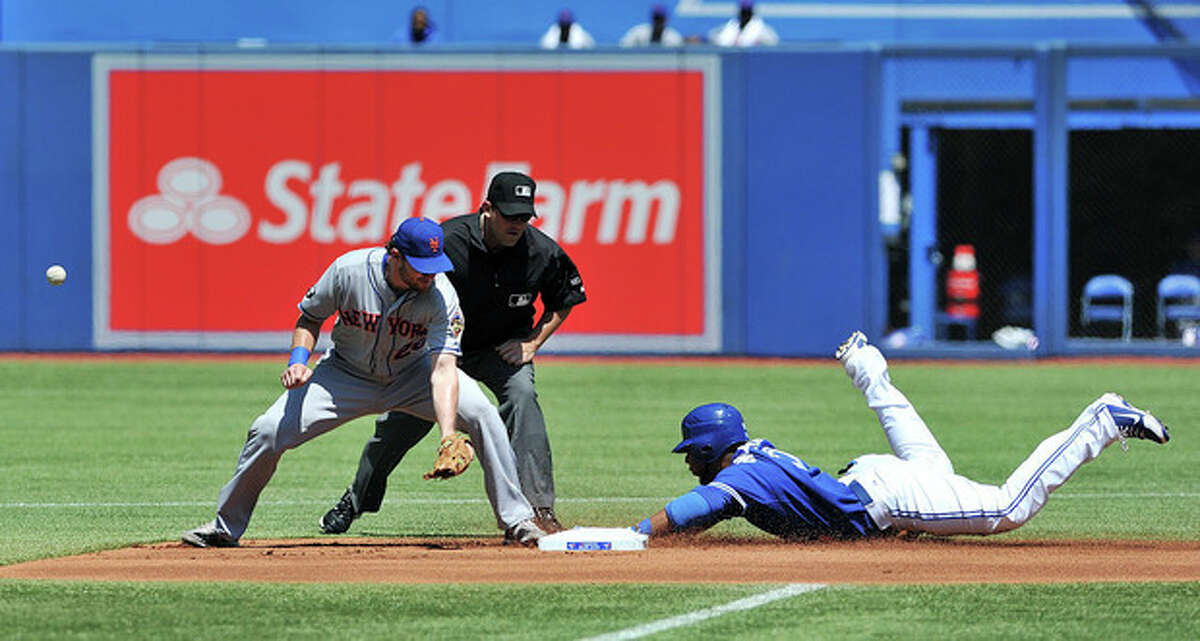 New York Mets' Daniel Murphy, left, loses the ball as Toronto Blue Jays' Edwin Encarnacion slides into second after hitting a double during the second inning of an interleague baseball game in Toronto, Saturday May 19, 2011. (AP Photo/The Canadian Press, Aaron Vincent Elkaim)