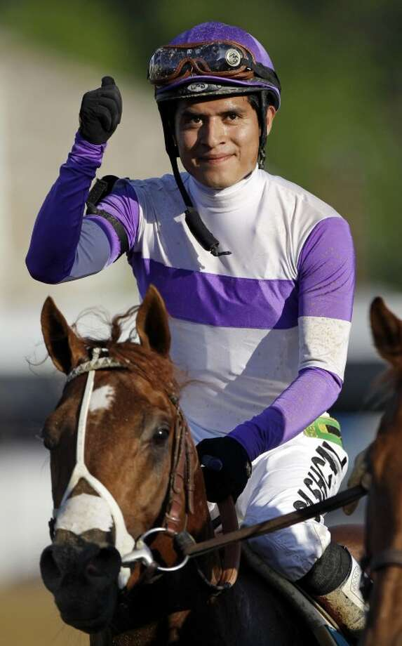 Jockey Mario Gutierrez reacts aboard I'll Have Another after winning the 137th Preakness Stakes horse race at Pimlico Race Course, Saturday, May 19, 2012, in Baltimore. (AP Photo/Patrick Semansky)