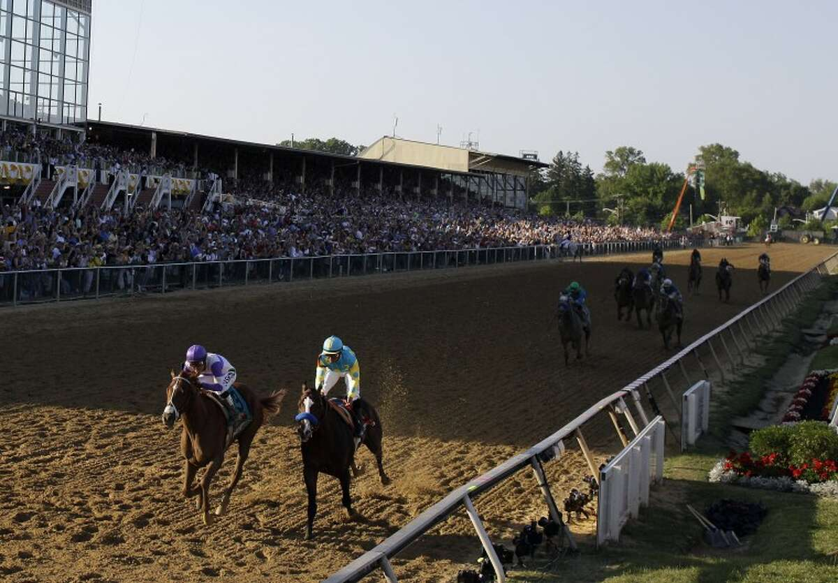 I'll Have Another, left, ridden by Mario Gutierrez, left, crosses the finish line ahead of Bodemeister, ridden by Mike Smith, to win the 137th Preakness Stakes horse race at Pimlico Race Course, Saturday, May 19, 2012, in Baltimore. (AP Photo/Matt Slocum)