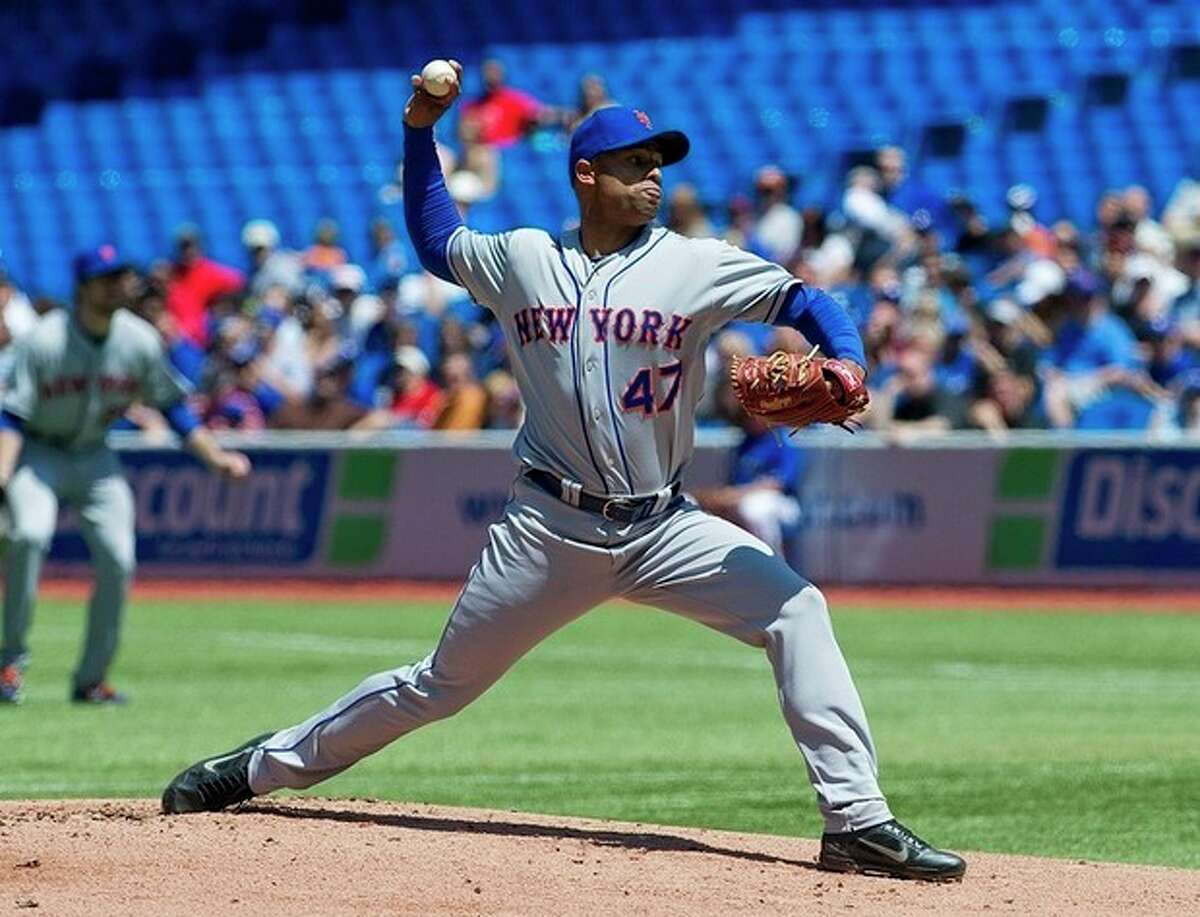 New York Mets pitcher Miguel Batista throws against the Toronto Blue Jays during the first inning of an interleague baseball game in Toronto, Saturday May 19, 2011. (AP Photo/The Canadian Press, Aaron Vincent Elkaim)