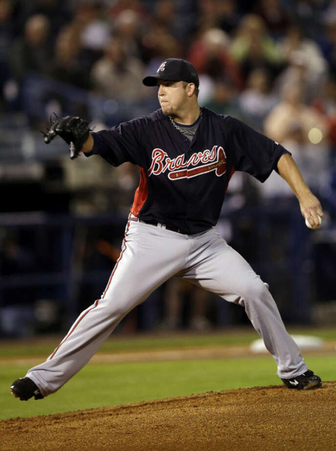 Atlanta Braves' Paul Maholm pitches during the first inning of a spring training exhibition baseball game against the New York Yankees, Tuesday, March 5, 2013, in Tampa, Fla. (AP Photo/Matt Slocum)