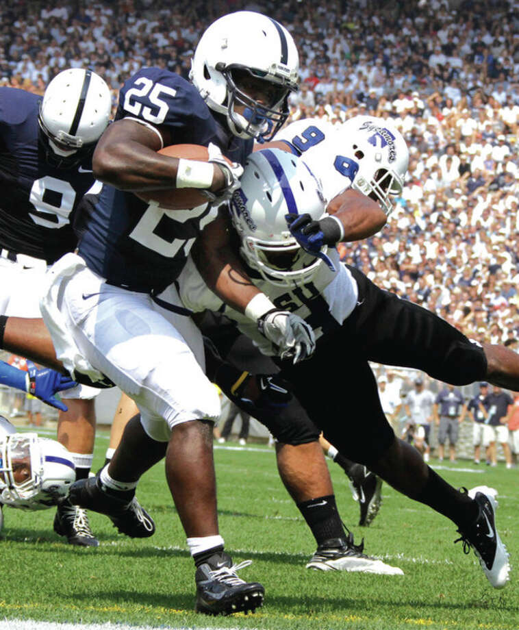 AP photo Penn State running back Silas Redd gets into the end zone for a touchdown past Indiana State defender Julian Easterly (6) during the first quarter of Saturday's game. A Norwalk resident, Redd ran for 104 yards and two TDs in Penn State's 41-7 win. / AP