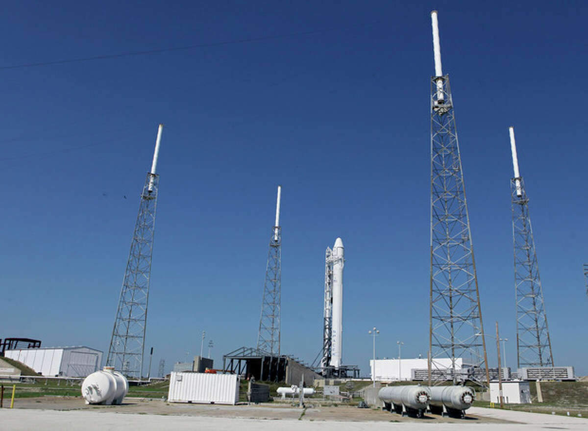 The Falcon 9 SpaceX rocket stands ready for launch at complex 40 at the Cape Canaveral Air Force Station in Cape Canaveral, Fla., Friday, May 18, 2012. The launch, scheduled for early Saturday morning will mark for the first time, a private company will send its own rocket to the orbiting International Space Station, delivering food and ushering in a new era in America's space program. (AP Photo/John Raoux)