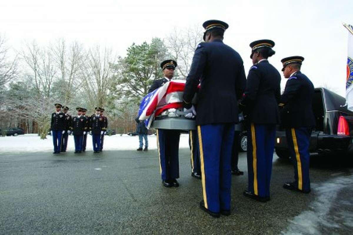 Members of a military honor guard carry the coffin of one of the 20 U.S. military veterans whose remains were unclaimed during their burial ceremony at Calverton National Cemetery, Saturday, Jan. 8, 2011, in Calverton, N.Y. The ceremony, sponsored by the Dignity Memorial network, has provided services for more than 850 veterans since its inception in 2000. (AP Photo/Mary Altaffer)