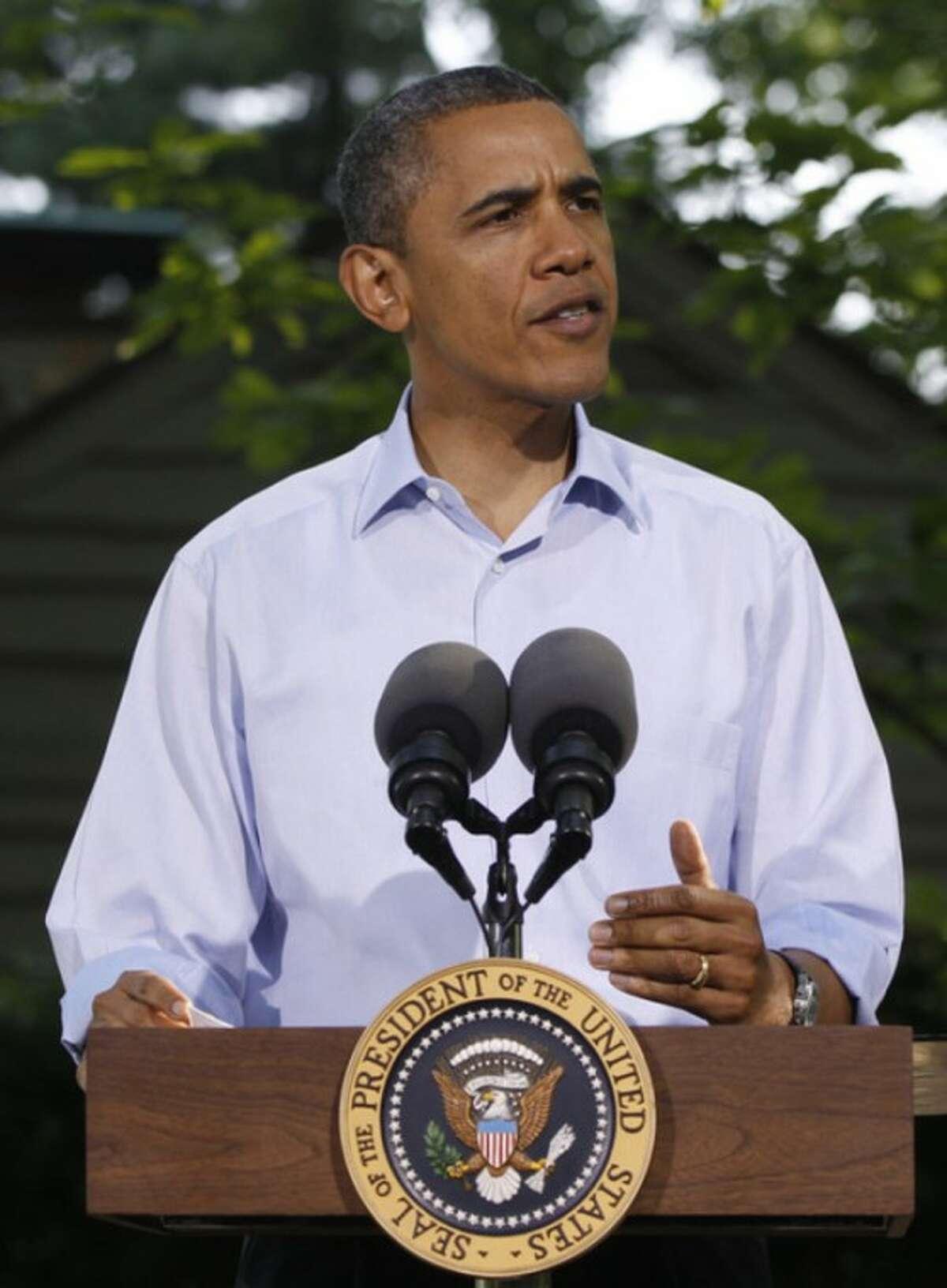 President Barack Obama briefs journalists following the G-8 Summit Saturday, May 19, 2012 at Camp David, Md. (AP Photo/Charles Dharapak)