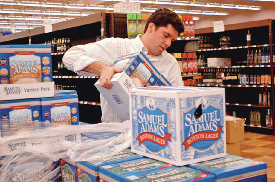 Sam Adams employee stocks beer at Wine Nation on Main Ave in Norwalk.