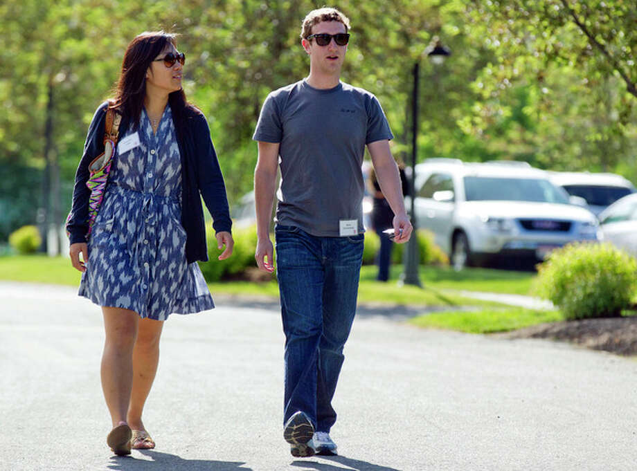 FILE- In this July 9, 2011, file photo, Mark Zuckerberg, president and CEO of Facebook, walks to morning sessions with his girlfriend Priscilla Chan during the 2011 Allen and Co. Sun Valley Conference, in Sun Valley, Idaho. On Saturday, May, 19, 2012, Zuckerberg and Chan tied the knot at a small ceremony at his Palo Alto, Calif., home, capping a busy week for the couple (AP Photo/Julie Jacobson) / 2011 AP