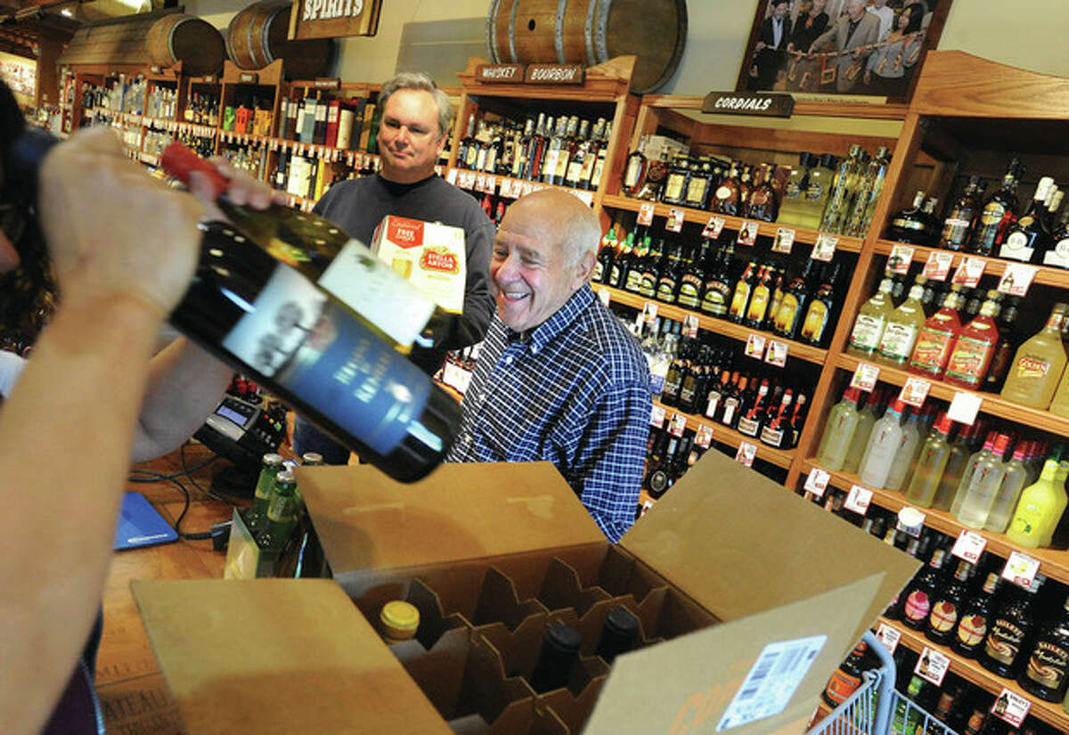 Hour photo / Matthew Vinci Marty Bell of Westport stocks up at Stew Leonard's Wines in Norwalk on the first Sunday residents can legally purchase alcohol.