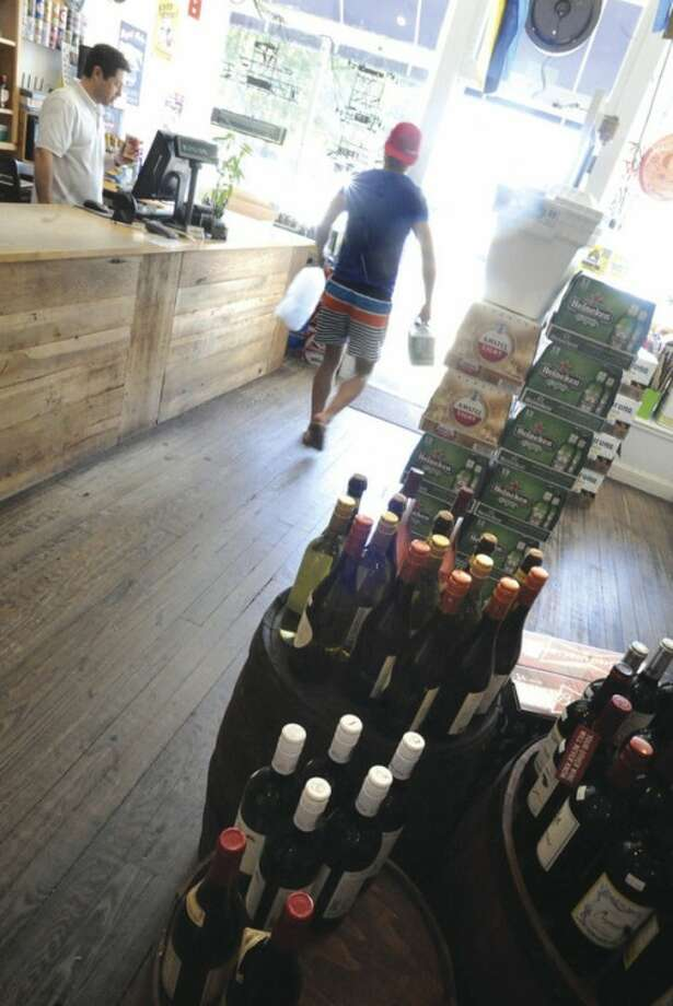 A patron leaves Ninety 9 Bottles at Liberty Square in Norwalk on the first Sunday residents can legally purchase alcohol.