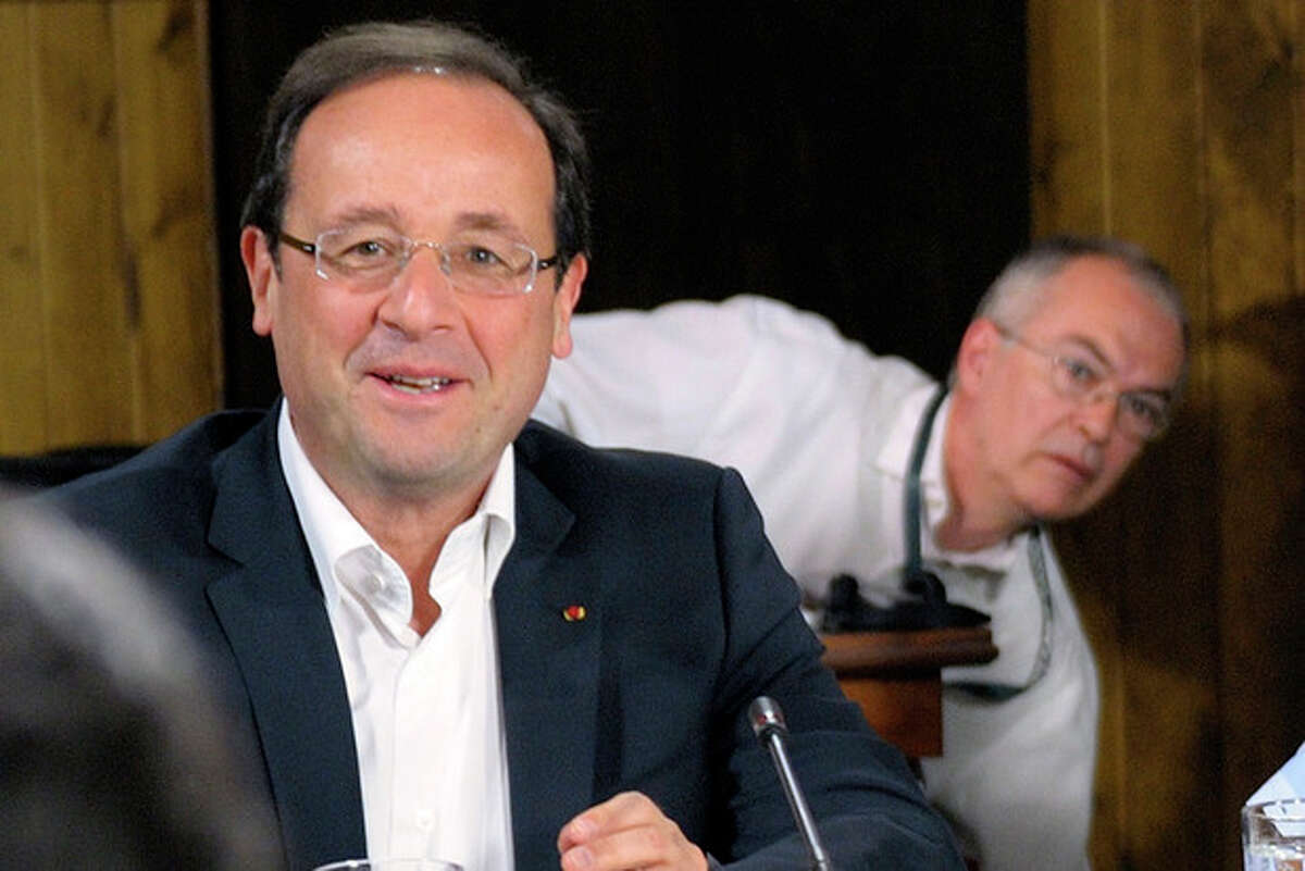 French President Francois Hollande, left, and his diplomatic advisor Paul Jean-Ortiz, shown at the start of the first working session of the G-8 Summit at Camp David, Md., Saturday May 19, 2012 (AP Photo/Philippe Wojazer)