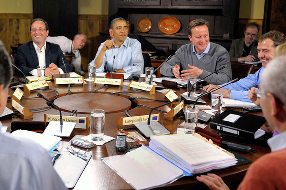 World leaders attend the first working session of the G-8 Summit at Camp David, Md,, Saturday, May 19, 2012. From left are French President Francois Hollande, U.S. President Barack Obama, British Prime Minister David Cameron and Russian Prime Minister Dmitri Medvedev. (AP Photo/Philippe Wojazer, Pool) / Reuters Pool