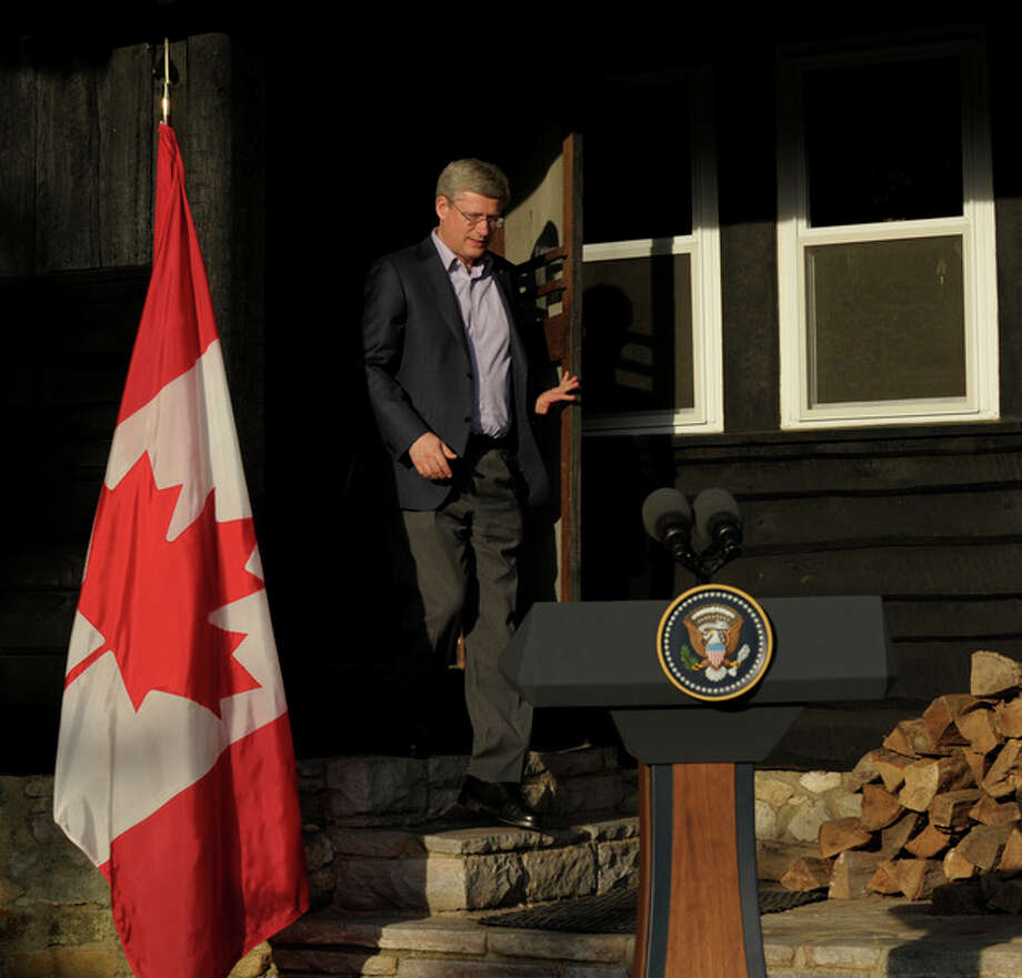 Canadian Prime Minister Stephen Harper arrives to speak to reporters following the G-8 Summit at Camp David, Md., Saturday, May 19, 2012. (AP Photo/Susan Walsh) / AP