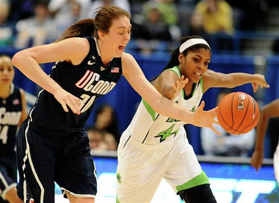Connecticut's Breanna Stewart, left, steals the ball from Notre Dame's Ariel Braker, right, in the second half of an NCAA college basketball game in the final of the Big East Conference women's tournament in Hartford, Conn., Tuesday, March 12, 2013. (AP Photo/Jessica Hill) / FR125654 AP