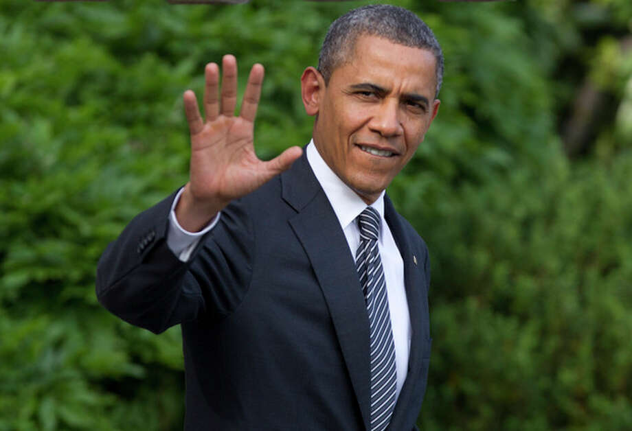 President Barack Obama waves as he walks from the White House in Washington, Friday, May 18, 2012, to board Marine One, as he travels to Camp David for the G8 Summit. (AP Photo/Carolyn Kaster) / AP