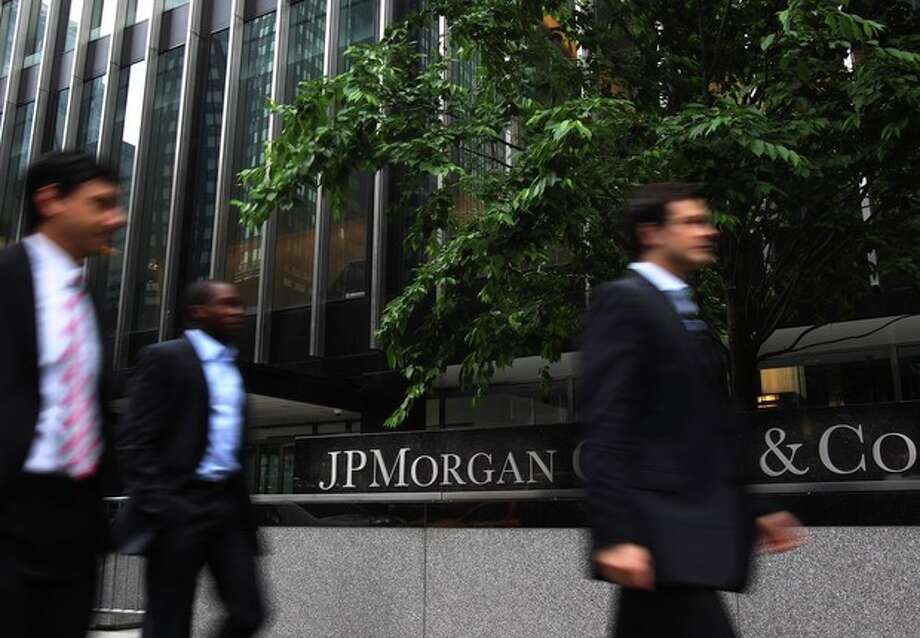 Pedestrians walk past JPMorgan Chase headquarters in New York, Wednesday, May 16, 2012. U.S. House Republican Rep. Shelly Moore Capito, chairman of the House Financial Services subcommittee, on Wednesday said that the $2 billion trading loss at JPMorgan Chase raises critical questions about how banks control their risks. But Republican lawmakers rejected calls from Democrats for stricter oversight of Wall Street. (AP Photo/Seth Wenig) / AP