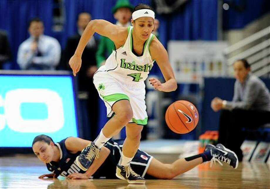 Notre Dame's Skylar Diggins top, steals the ball from Connecticut's Bria Hartley first half of an NCAA college basketball game in the final of the Big East Conference women's tournament in Hartford, Conn in Hartford, Conn., Tuesday, March 12, 2013. (AP Photo/Jessica Hill) / FR125654 AP