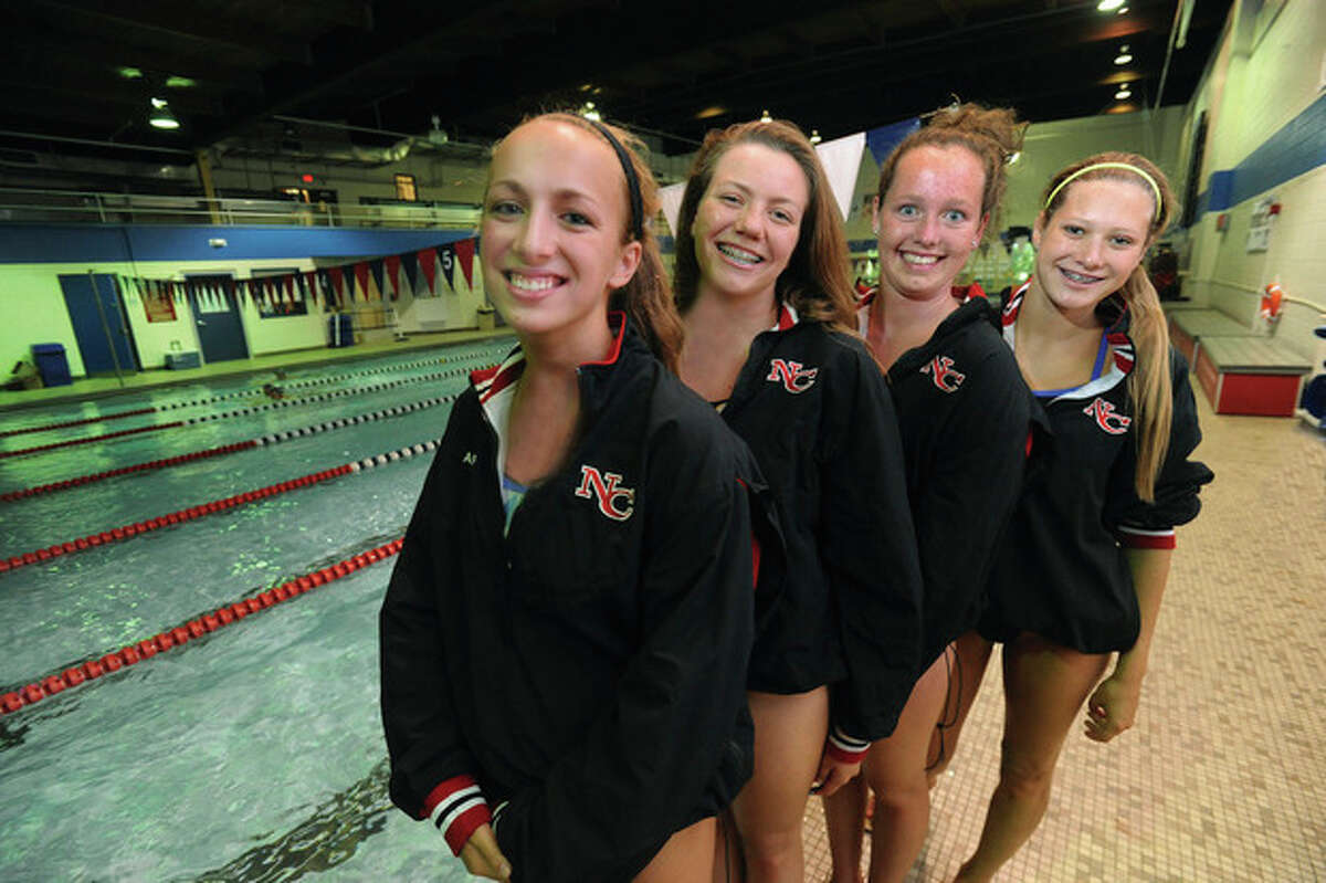 Hour photo/Matthew Vinci A year ago New Canaan's Adelyn Graft, Erin Dunstan, Emma Tobey and Maddie Rusch teamed up to win the 200 medley relay at the State Open girls swim meet and set a state record in the event at the Class L championship meet. They're all back and eager to see what they can do during this fall's campaign. Their success in what is usually the first event of a meet often sets the tone for the Rams, who will be pursuing a second straight Class L title.