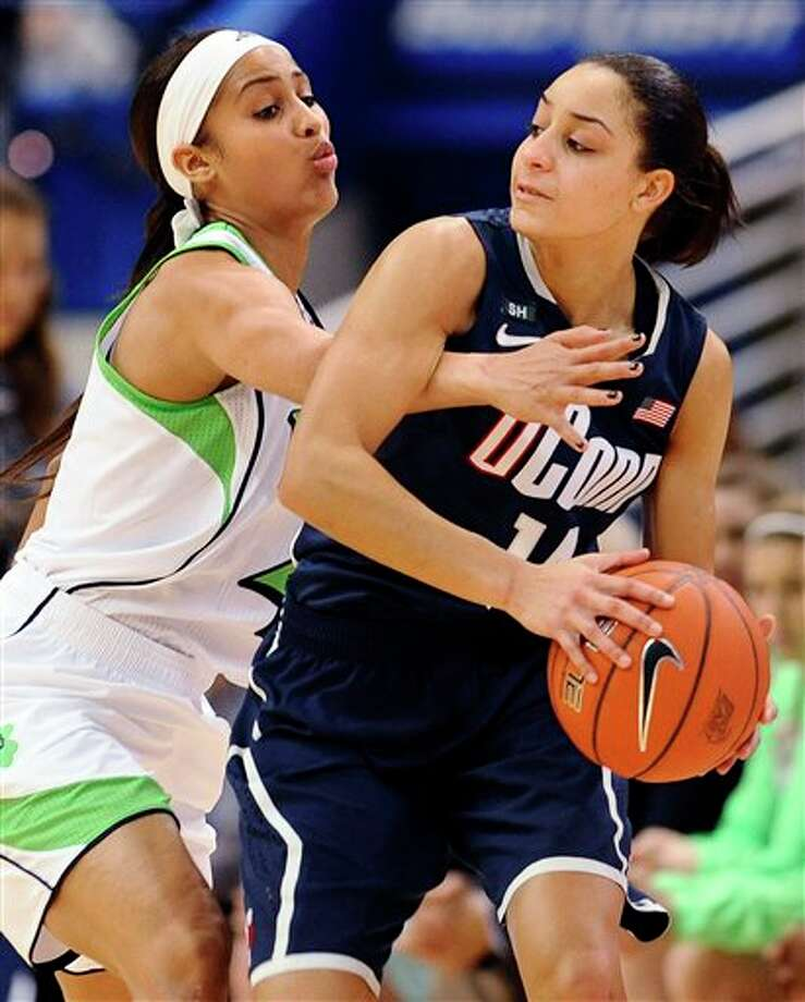 Connecticut's Bria Hartley, right, is guarded by Notre Dame's Skylar Diggins in the first half of an NCAA college basketball game in the final of the Big East Conference women's tournament in Hartford, Conn., Tuesday, March 12, 2013. (AP Photo/Jessica Hill) / FR125654 AP