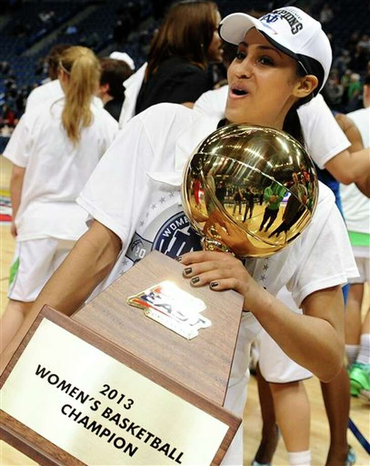 Notre Dame's Skylar Diggins holds up the Big East Conference women's tournament championship trophy after their 61-59 win over Connecticut in an NCAA college basketball game in Hartford, Conn., Tuesday, March 12, 2013. (AP Photo/Jessica Hill) / FR125654 AP