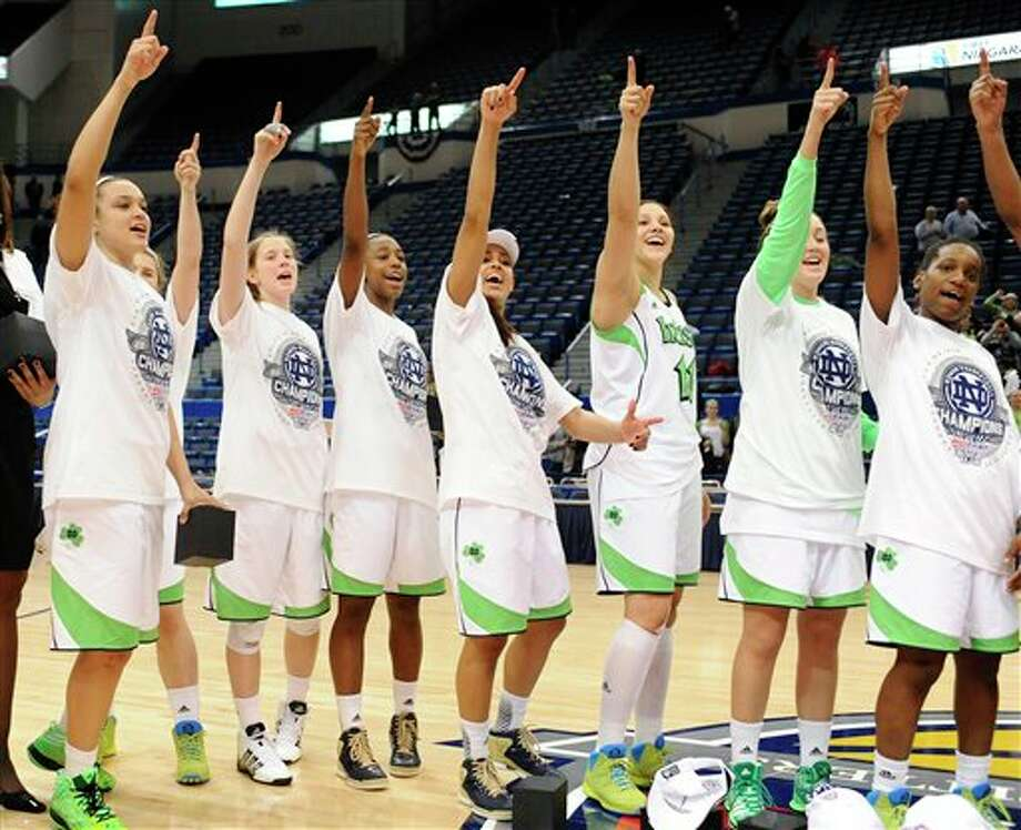 Notre Dame celebrates their Big East Conference women's tournament championship win over Connecticut in an NCAA college basketball game in Hartford, Conn., Tuesday, March 12, 2013. (AP Photo/Jessica Hill) / FR125654 AP