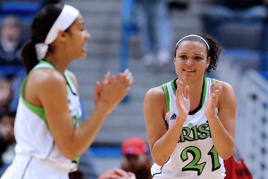 Notre Dame's Skylar Diggins and Kayla McBride react in the second half of an NCAA college basketball game against Louisville in the semifinals of the Big East Conference women's tournament in Hartford, Conn., Monday, March 11, 2013. Notre Dame won 83-59. (AP Photo/Jessica Hill) / FR125654 AP