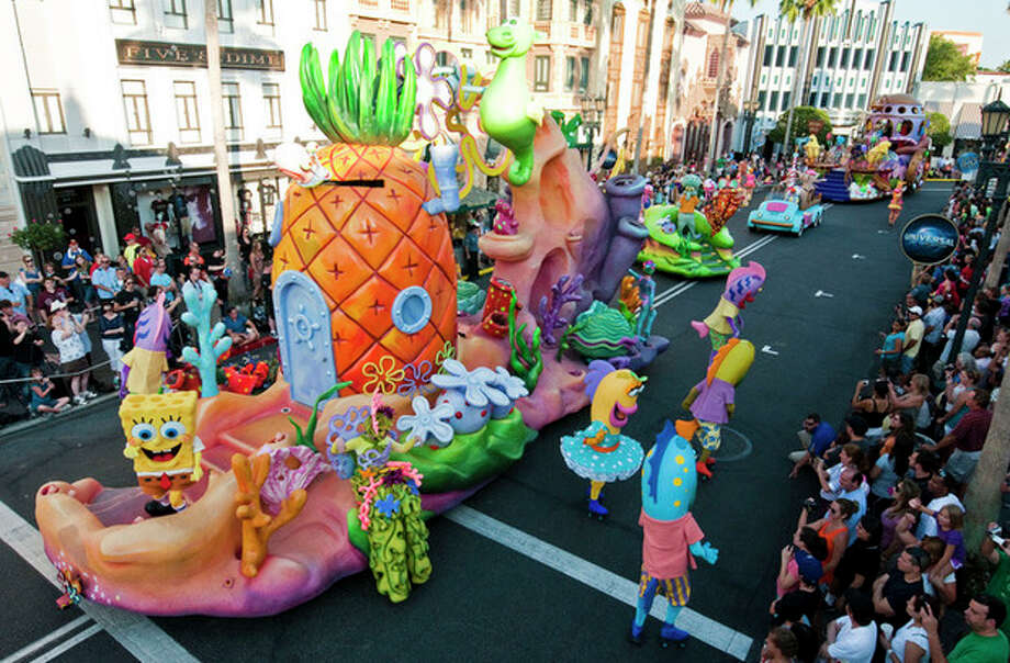 """In this May 2012 photo released by Universal Orlando Resort, characters from Nickelodeon's """"SpongeBob SquarePants"""" program are shown during the new Superstar Parade at Universal Orlando in Orlando, Fla. The attraction offers floats with hundreds of performers and characters from animated films and TV shows including """"Despicable Me,"""" """"Hop,"""" Nickelodeon's """"SpongeBob SquarePants"""" and """"Dora & Diego."""" The parade, which debuted in early May, is one of a number of new attractions at theme parks around the country this season. (AP Photo/Universal Orlando Resport, Ed Hall) / ©2012 Universal Orlando. All rights reserved."""