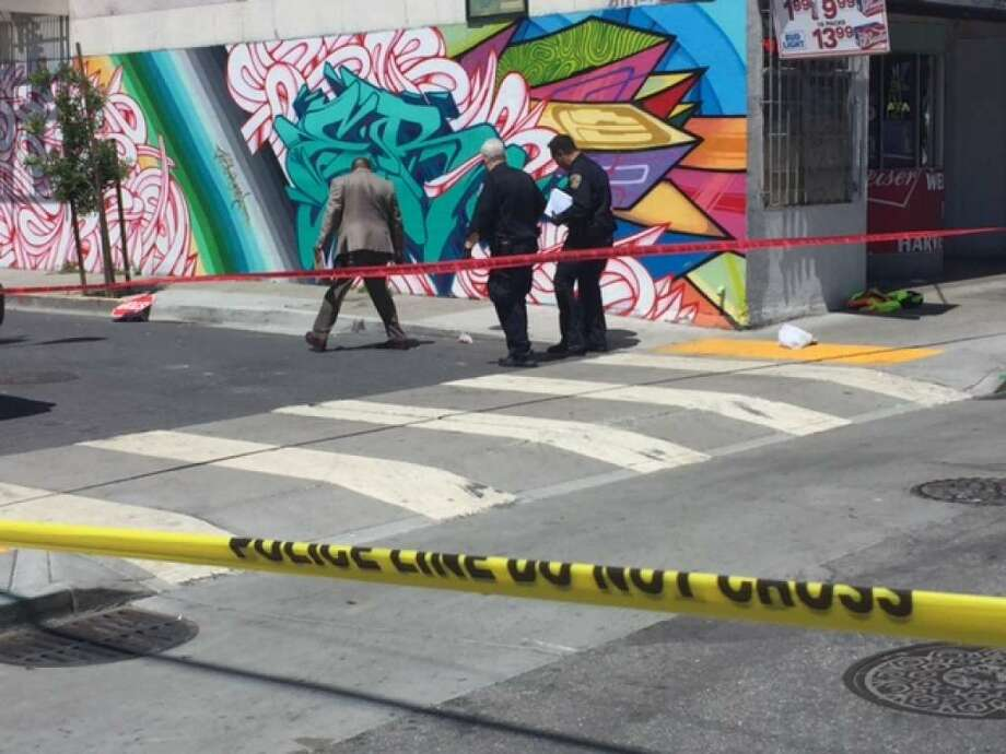 San Francisco police investigate a stabbing on Friday in the South of Market area that left construction worker Mitzi Campbell, 58, dead. Photo: Kevin Schultz / The Chronicle / /