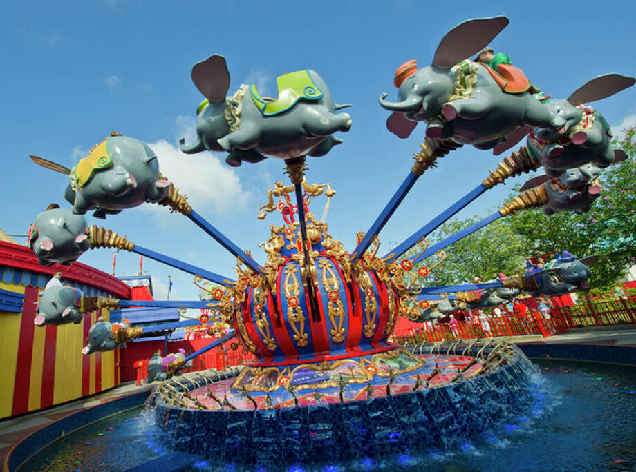 """In this May 12, 2012 photo released by Disney theme parks, people ride the """"Dumbo the Flying Elephant,"""" attraction in the new Storybook Circus area of Fantasyland at Magic Kingdom Park in Lake Buena Vista, Fla. The renovation and new construction at Fantasyland inside the Magic Kingdom in Florida is the largest expansion project in the park's 40-year history, doubling the size of the current Fantasyland. (AP Photo/Disney, Gene Duncan) / Disney"""