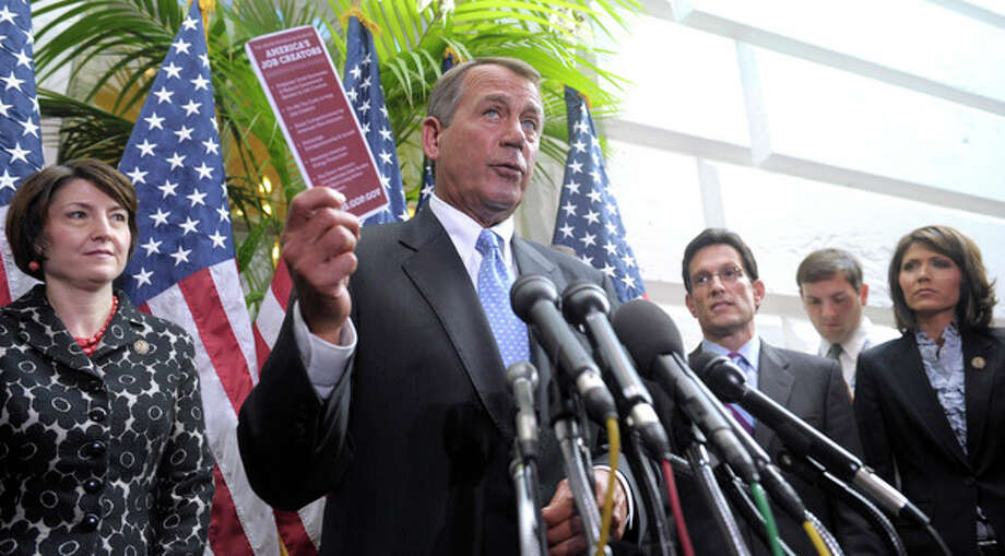 House Speaker John Boehner of Ohio speaks to reporters on Capitol Hill in Washington, Wednesday, Nov. 30, 2011, following a closed-door meeting. From left are, Rep. Cathy McMorris Rodgers, R-Wash., House Majority Leader Eric Cantor, R-Va., and Rep. Kristi Noem, R-S.D., right. (AP Photo/Susan Walsh) / AP