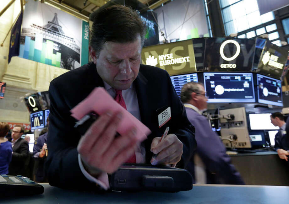 FILE - In this Friday, March 1, 2013 file photo, Trader Edward Schreier works on the floor of the New York Stock Exchange. World stock markets edged off recent highs in uneven trading Tuesday March 12, 2013 as worries grew about China's recovery and Europe's doldrums. (AP Photo/Richard Drew) / AP