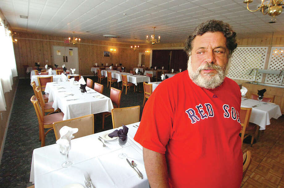 Hour Photo/ Alex von KleydorffSam Tuozzolo, president of The Sons of Italy, stands in the Tivoli Dinning room / 2012 The Hour Newspapers
