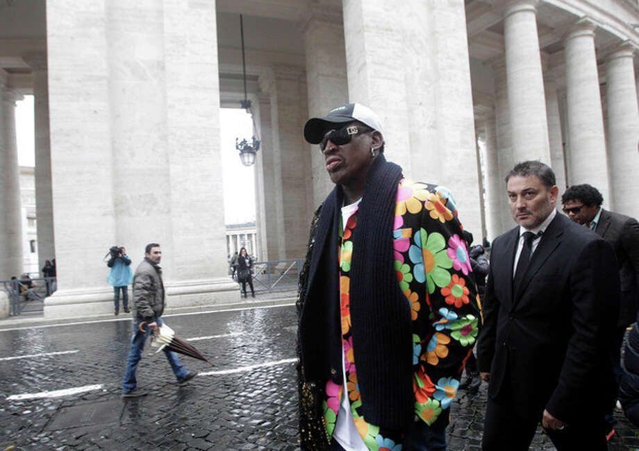 Former NBA star Dennis Rodman walks by the Bernini Colonnade near St. Peter's Square at the Vatican, Wednesday, March 13, 2013. Rodman is in Rome to promote the papal candidacy of Cardinal Peter Turkson of Ghana. ((AP Photo/Riccardo De Luca) / AP