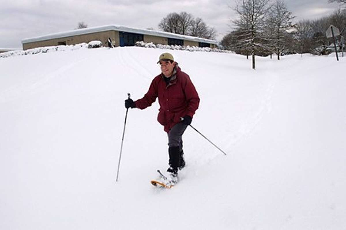 Jim Hamilton snowshoes to his home on Strawberry Hill Ave. following the snowstorm early Thursday morning. Hour photo / Erik Trautmann