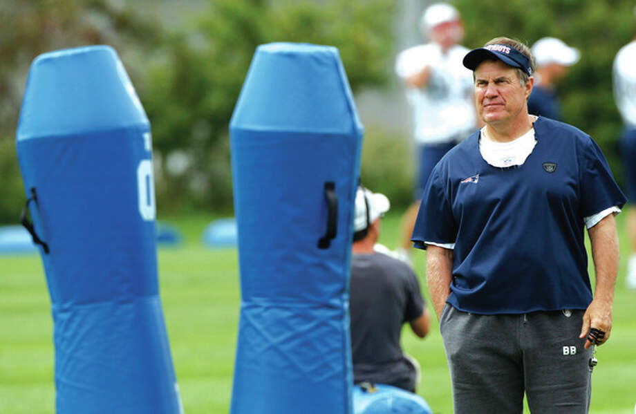 @White=[C] AP photo New England Patriots head coach Bill Belichick watches his players during practice Tuesday in Foxborough, Mass. Belichick says the NFL's new rules for kickoffs may cost some special teamers jobs. / AP