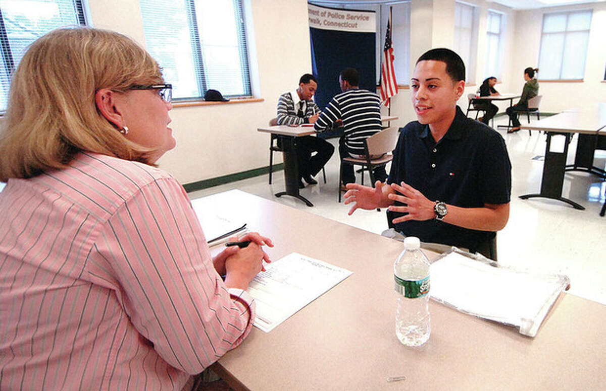 Hour Photo/ Alex von Kleydorff. 16 yr old Briggs High School Jr. Alex Ortega interviews with Erin Halsey for the Mayors Summer Job Program