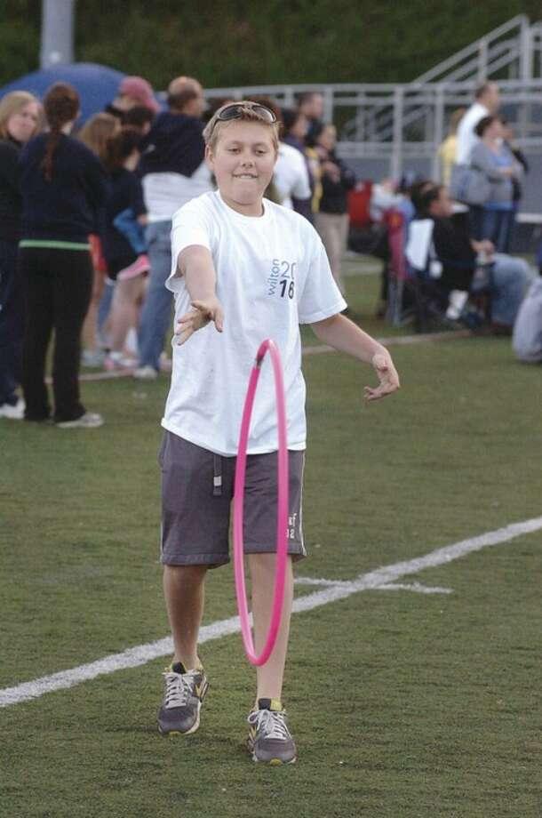 Hour Photo/ Alex von Kleydorff. 13yr old Jordan Hirn spins a hoop to a friend at Wiltons Relay for Life.