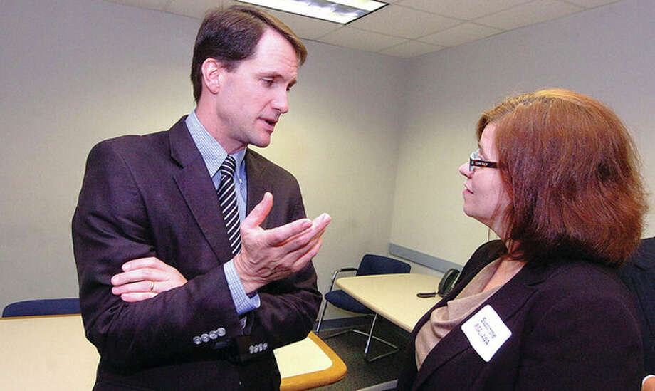Hour photo / Alex von KleydorffCongressman Jim Himes talks with Laura Cordes, executive director of the Connecticut Sexual Crisis Service, after a press conference calling for bipartisan action on Senate legislation. / 2012 The Hour Newspapers