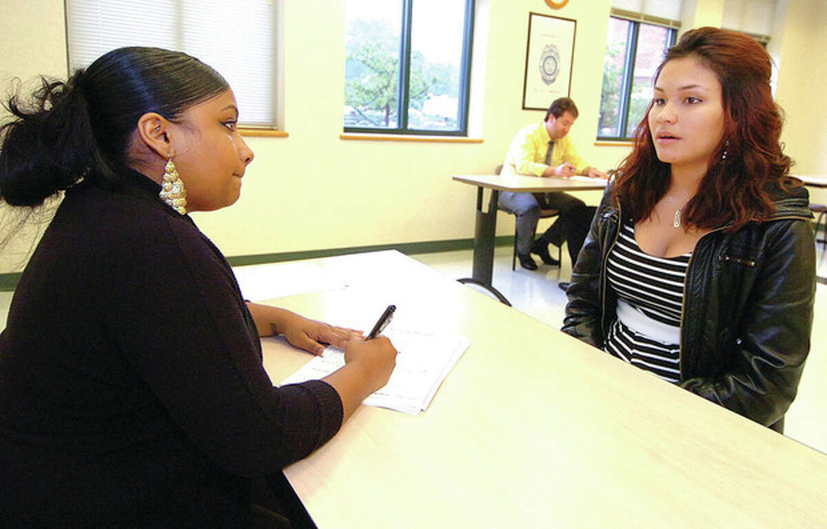 Hour Photo/ Alex von Kleydorff. Volunteer Diane Matheus talks with 16yr old Lina Parra during an interview for a spot in the Mayors Summer Job Program