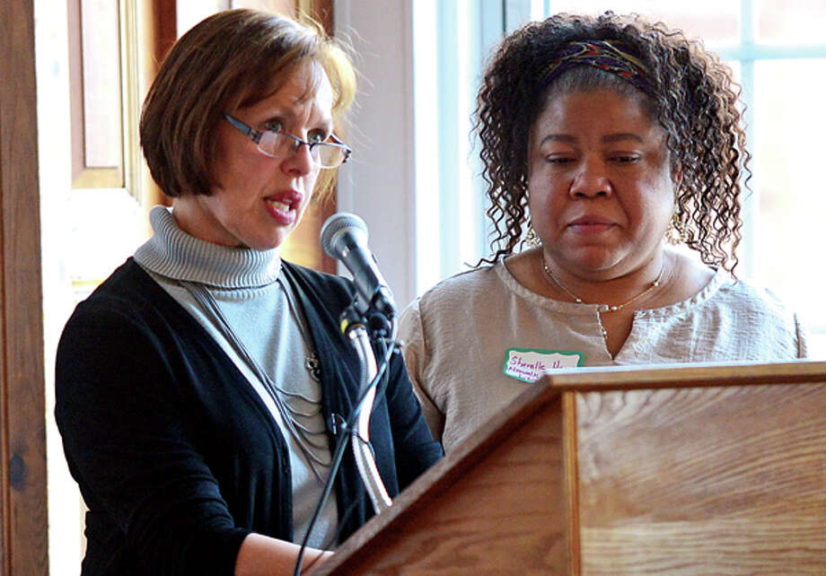 Co-chair Mary Oster and Director of the South Norwalk Branch Library Sherelle Harris speak at The Norwalk Early Childhood Council (NECC)Early Childhood Plan Launch of their 2013-2016 plan Wednesday morning in the City Hall Community Room. Hour photo / Erik Trautmann / (C)2013, The Hour Newspapers, all rights reserved