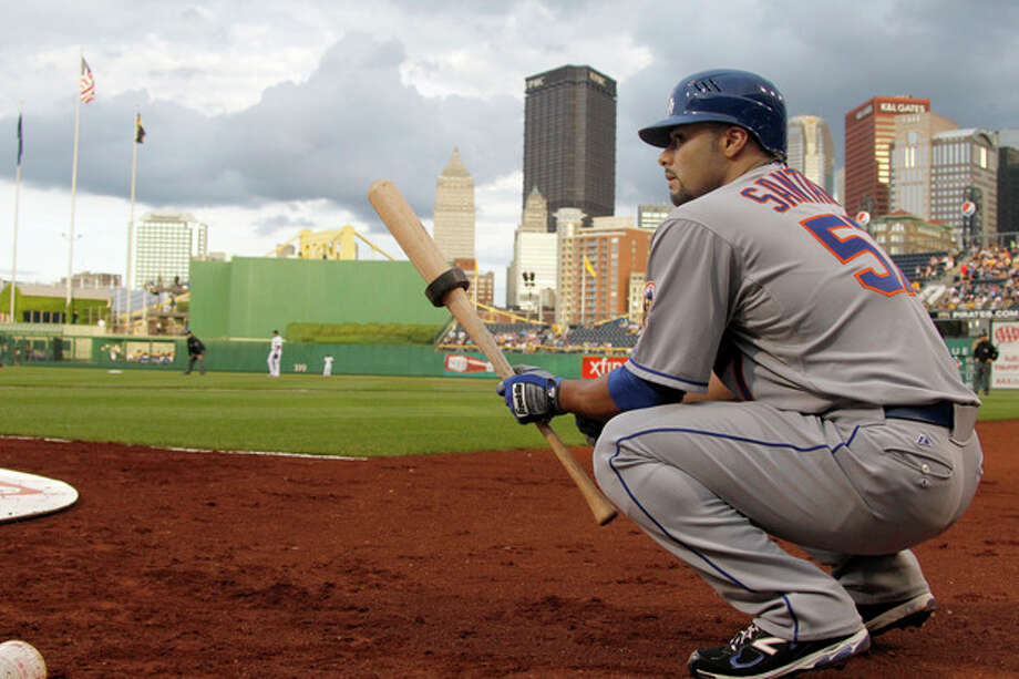 New York Mets starting pitcher Johan Santana waits on deck to bat against the Pittsburgh Pirates in the second inning of the baseball game on Monday, May 21, 2012, in Pittsburgh. (AP Photo/Keith Srakocic ) / AP