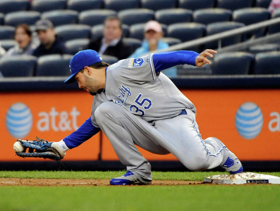 Kansas City Royals first baseman Eric Hosmer holds onto the ball to get New York Yankees' Derek Jeter on a groundout during the first inning of a baseball game, Monday, May 21, 2012, at Yankee Stadium in New York. (AP Photo/Bill Kostroun) / FR51951 AP