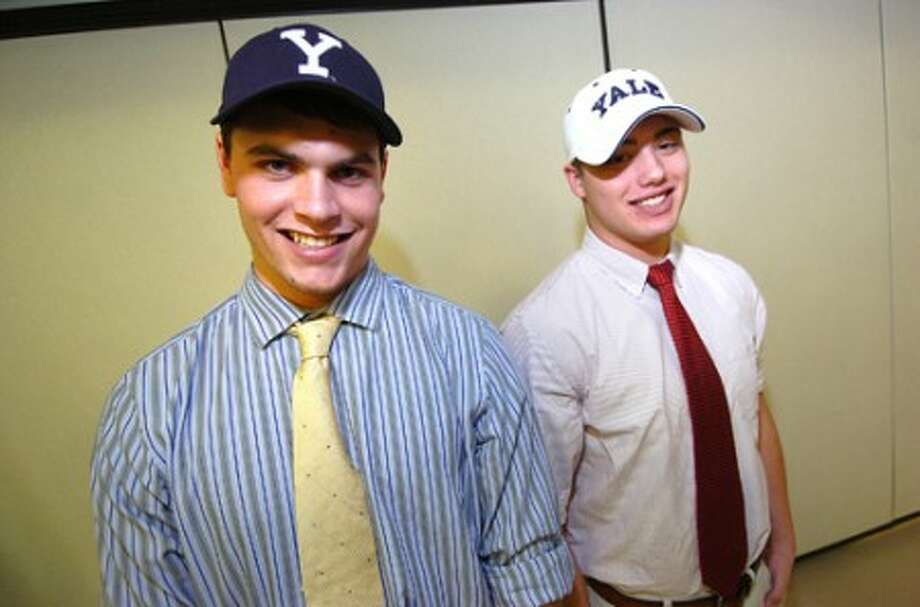 Photo/Alex von Kleydorff. Staples High School seniors Chris Coyne and Pat Murray sign to play football at Yale.