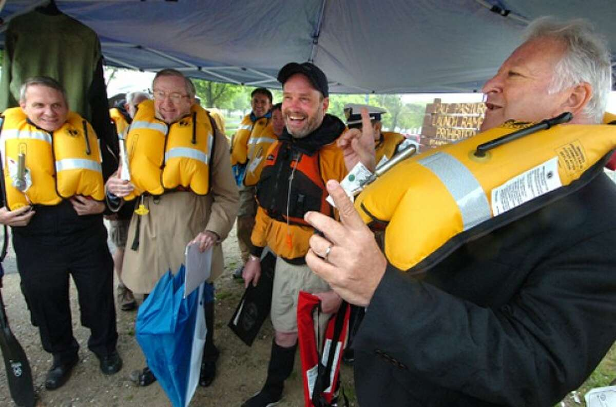 Photo by Alex von Kleydorff. At Calf pasture Beach in Norwalk, Mayor Richard Moccia along with Wilton First Selectman Bill Brennan and Wilton Fire Chief Paul Milositz, David Park gives the command Ready.. Set.. Inflate, pull the handle and inflate their personal flotation devices at a press conference for Kayak and Canoe Safety Awareness Week.