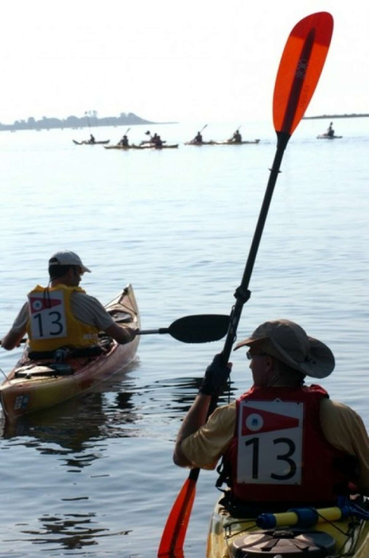 Kayakers with Pod 13 set out on the 8th annual Kayak for a Cause from Calf Pasture Beach Saturday. Hour photo / Erik Trautmann