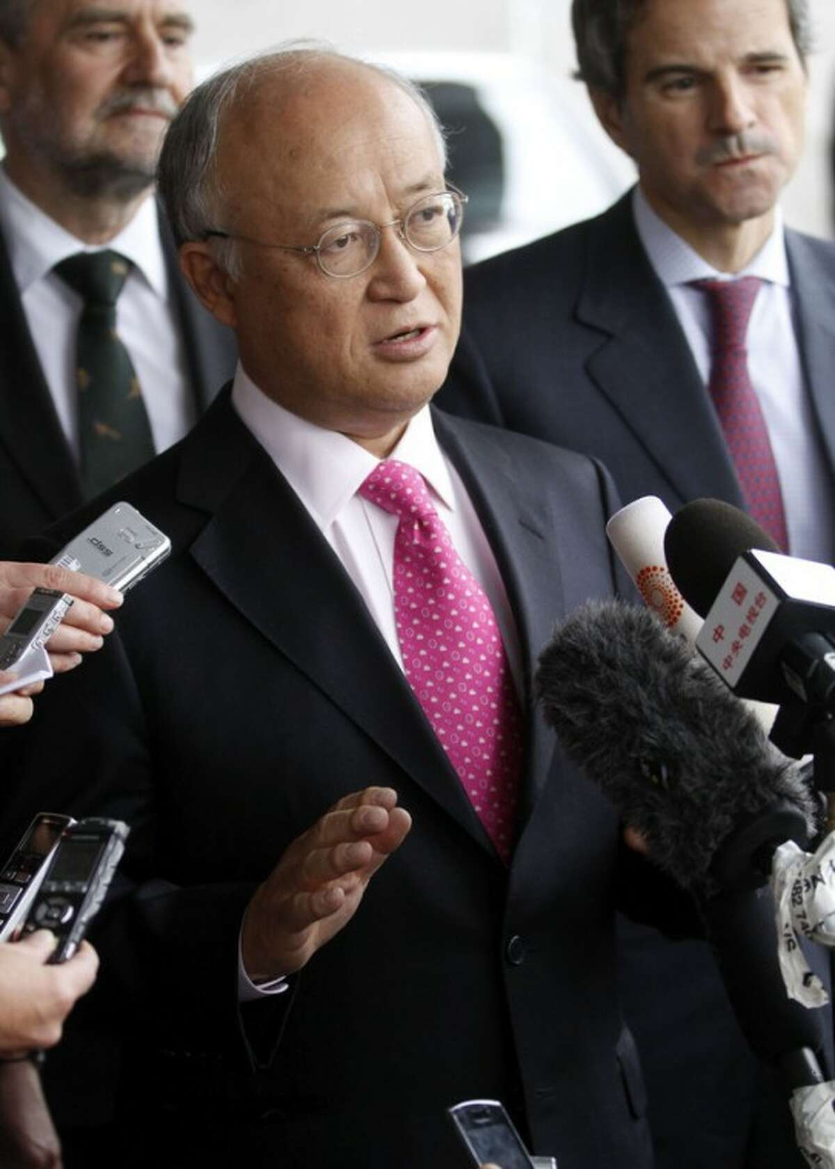 Director General of the International Atomic Energy Agency, IAEA, Yukiya Amano from Japan speaks to the media after returning from Iran at the Vienna International Airport near Schwechat, Austria, on Tuesday, May 22, 2012. Amano says he has reached a deal with Iran on probing suspected work on nuclear weapons and adds that the agreement will
