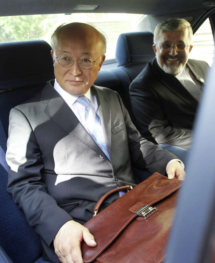 International Atomic Energy Agency (IAEA) chief Yukiya Amano, left, sits in his car as he leaves at the conclusion of his meeting with Iran's top nuclear negotiator, Saeed Jalili, unseen, as Iran's chief delegate to the IAEA Ali Asghar Soltanieh looks on, in Tehran, Iran, Monday, 21, 2012. The head of the U.N. nuclear agency arrived Monday in Tehran on a key mission that could lead to the resumption of probes by the watchdog on whether Iran has secretly worked on an atomic weapon. It would also strength the Islamic Republic's negotiating hand in crucial nuclear talks with six world powers later this week in Baghdad. (AP Photo/IRNA,Adel Pazzyar) / Islamic Republic News Agency, IRNA